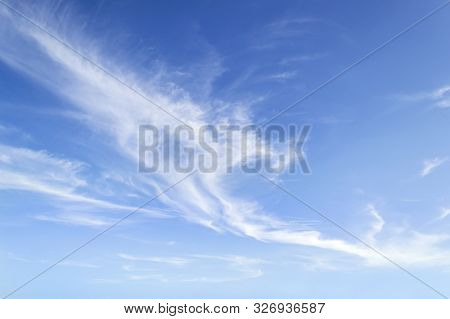 Translucent Airy Cirrus Clouds High In A Blue Sky. Cloud Species And Varieties. Atmospheric Phenomen
