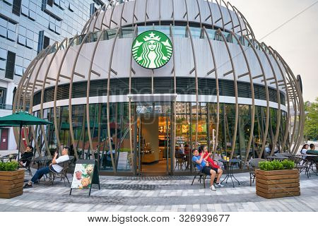 SHENZHEN, CHINA - CIRCA APRIL, 2019: entrance to Starbucks Coffee in Shenzhen. Starbucks Corporation is an American coffee company and coffeehouse chain.