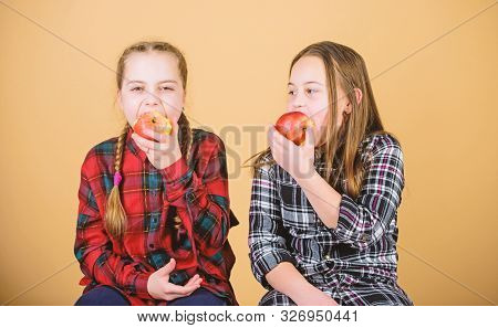 Healthy Dieting And Vitamin Nutrition. Girls Friends Eat Apple Snack While Relaxing. School Snack Co