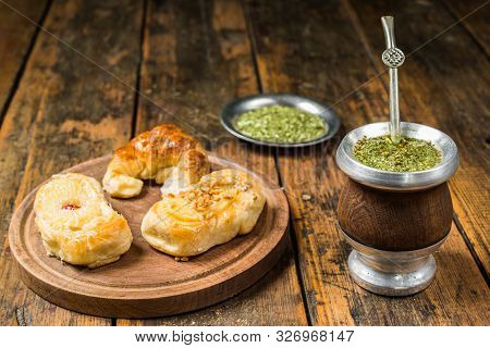 Traditional Argentinian Yerba Mate Tea In Calabash Gourd And Argentine Pastries.