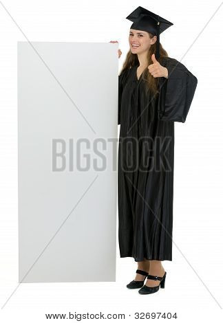 Graduation Student Holding Blank Billboard And Showing Thumbs Up