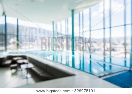 Indoor Swimming Pool In Blur Background. Abstract Blurry Swimming Pool In Fitness Centre.