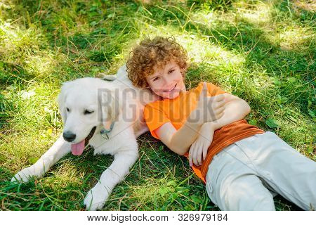 Cute Boy Lies On His Dog With Spread Smile And Shows Ok Gesture To Reflect His Mood. One Day From Th