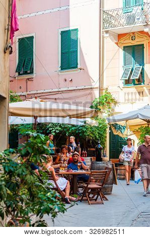 Monterosso Al Mare, Italy - September 02, 2019: People Are Sitting In Restaurant And Bars On The Coz