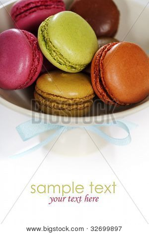 Colorful macaroons in a white plate (with sample text)