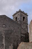 Old church belfry in Savoca village Sicily Italy in the evening poster