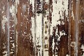 Old cupboard with cracked painted doors, texture of weathered cracked paint background texture poster