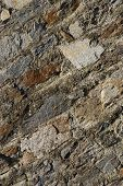 Close up of rough textured old stone wall poster