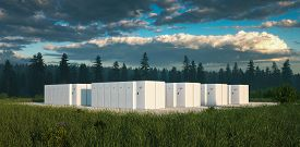 Eco Friendly Battery Energy Storage System In Nature With Misty Forest In Background And Fresh Grass