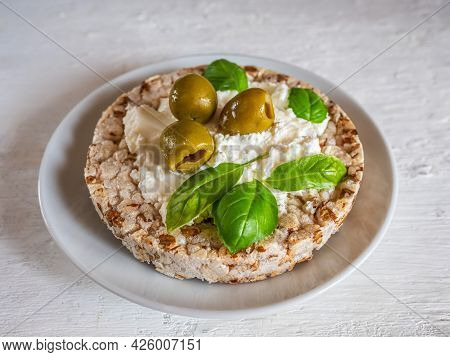 Snack, Curd Cheese On Grain Slack And Basil Greens On A Plate