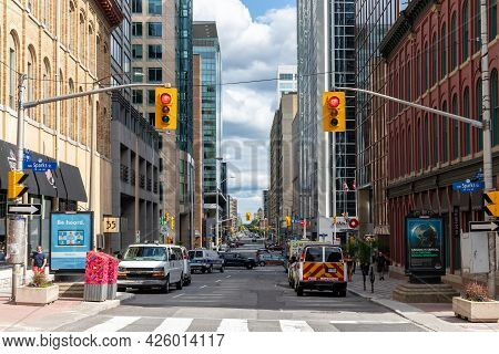 Ottawa, Canada - July 1, 2021: Wellington Street View With Walking People In Downtown Of Ottawa. Roa