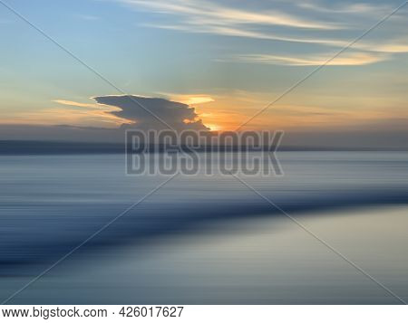 Sunset Behind The Clouds Over The Beach View. Sunset Sunrise On The Blue Sea Background. Colorful Su