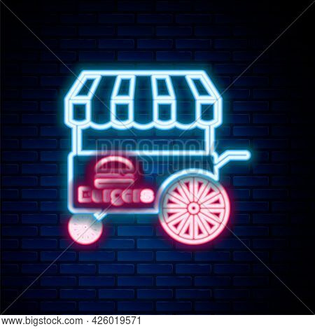 Glowing Neon Line Fast Street Food Cart With Awning Icon Isolated On Brick Wall Background. Burger O