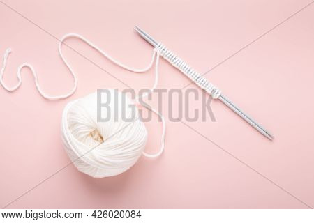 White Knitting Wool And Knitting Needles On Pastel Pink Background. Hobby Knitting. Top View - Image