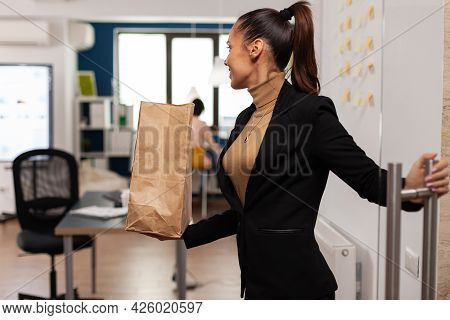 Entrepreneur Opening Glass At Corporate Business Office Holding Lunch Meal Takeaway Food. Corporate