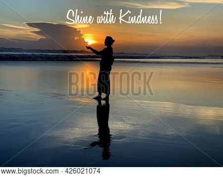 Inspirational Motivational Quote - Shine With Kindness. With Silhouette Of A Young Woman Holding Sun