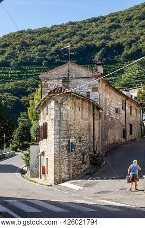 Santo Stefano, Italy - Sept 5, 2019:  Santo Stefano- Small Old Town And Hill With Vineyards Of The P