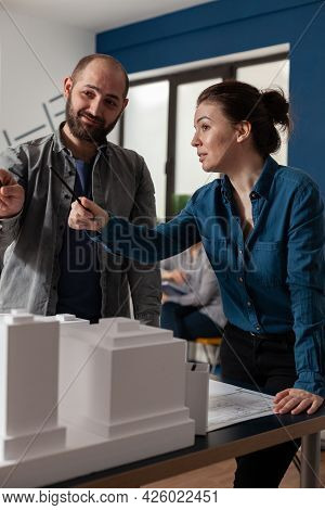 Architect Work Team Talking At Professional Office Standing At Desk With Maquette Building Model. Ca