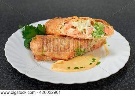 Puff Pastry Roll Stuffed With Salmon And Broccoli
