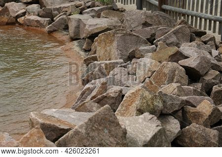 Limestone - Piles Of Natural Stones By The Lake