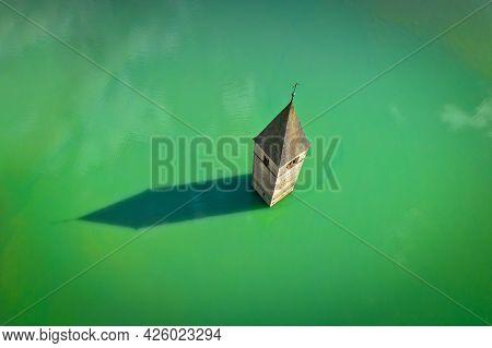 Submerged Bell Tower Of Curon At Graun Im Vinschgau On Lake Reschen Aerial View, South Tyrol Region