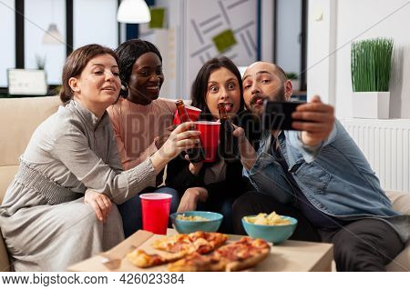 Diverrse Group Of Coworkers Taking Selfie On Smartphone After Work At Office Party. Cheerful Colleag