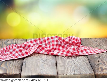Red Picnic Table Cloth Napkin On Wooden Plank Table Blur Nature Background.empty Space Table Food De
