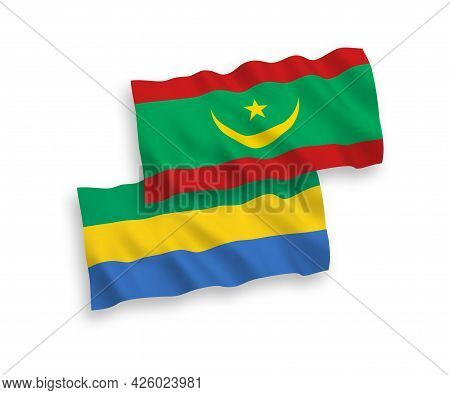 National Fabric Wave Flags Of Islamic Republic Of Mauritania And Gabon Isolated On White Background.