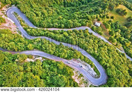 Curvy Road Serpentines In Green Alpine Ladscape Aerial View, Agueglio Pass Mountain Road Above Varen