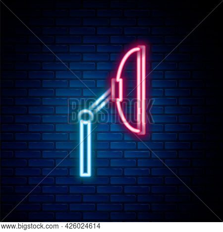Glowing Neon Line Windscreen Wiper Icon Isolated On Brick Wall Background. Colorful Outline Concept.