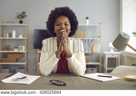 African American Business Woman Talking And Giving Online Advice To Her Client Using Laptop Webcam.