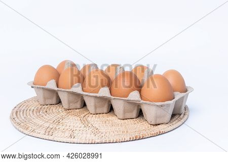 Close-up View Of Raw Chicken Eggs In Egg Box Isolated On White Background. Fresh Organic Chicken Egg