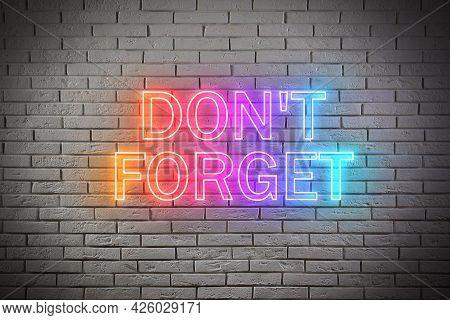 Phrase Don't Forget Against Brick Background. Reminder