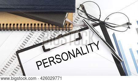Text Personality On Office Desk Table With Notebooks, Supplies,analysis Chart, On White Background.