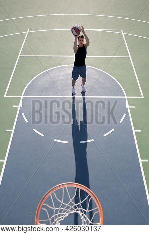 Basketball Player, Top View. Man Playing Basketball, Above Hoop Of Man Shooting Basketball.