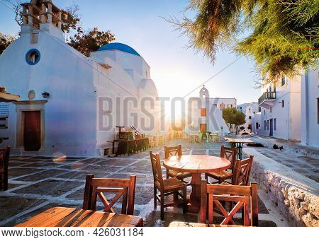 Sunrise In Alleyways Of Mykonos, Greece. Greek Whitewashed Churches In Small Town Square, Street Caf