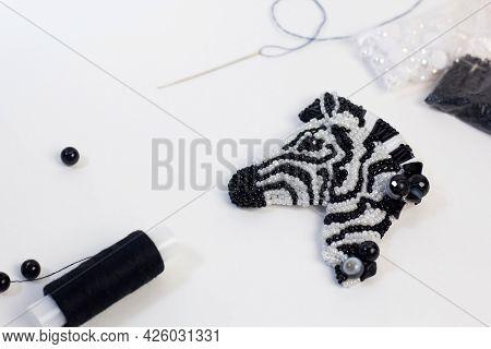 Handmade Beaded Zebra On White Background. Sewed Diy Present Workshop. Jewelry Designer Making Brooc