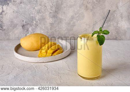 Mango Lassi, Smoothies Or Milkshake On Light Background. Traditional Indian Drink With Yogurt, Fruit