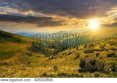 Carpathian Mountain Landscape At Sunset. Beatiful Scenery With Green Rolling Hills In Evening Light