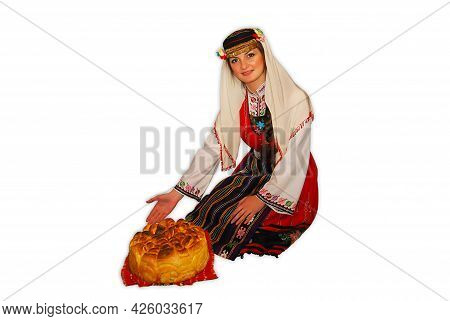 Young Girl Peasant With Traditional Bulgarian Folklore Costume And Sourdough Bread In Hand Portrait