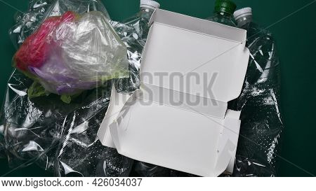 Cardboard Box And Plastic Trash Heap Sorting For Recycling. Waste Sorting Concept. Household Waste R