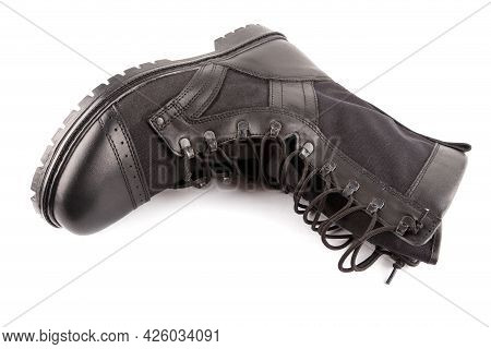 New Black Lightweight Military Boot Isolated On White Background, Lying On Its Side