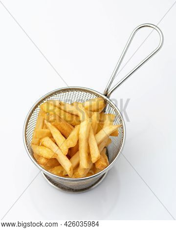Crispy Deep Fried Potato Fries In Metal Sieve Or Colander. Object Isolated On White Background. Appe