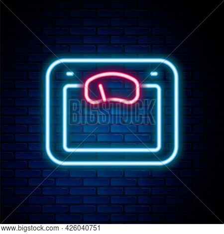 Glowing Neon Line Bathroom Scales Icon Isolated On Brick Wall Background. Weight Measure Equipment.