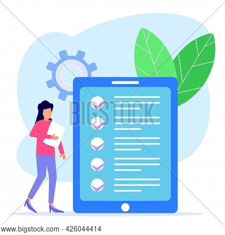 A Business Woman Checks A Checklist On An Electronic Tablet. Successful Completion Of Business Assig