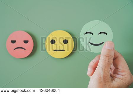 Hand Choose Green Paper Cut, Happy Smiling Face On Green Background For Mental Health Assessment ,po