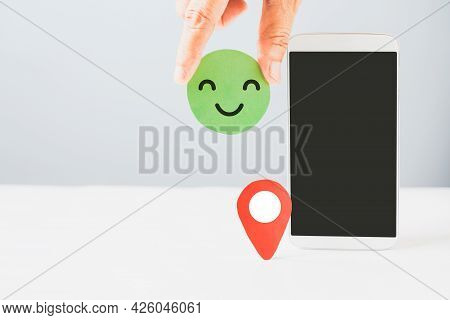 Hand Holding Good Emotion Green Paper Cut With White Mobile Phone With Clipping Path On Touchscreen