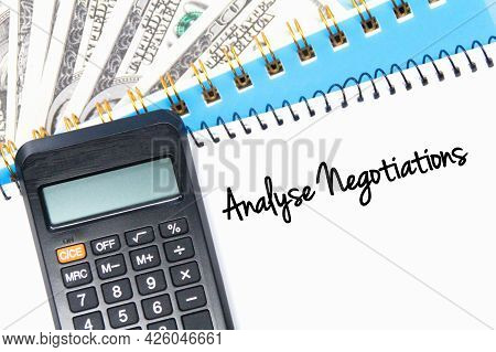 Banknotes, Calculators, Notebooks And Word Analyze Negotiations