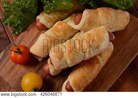 Sausage Buns. Soft Baked Bun (dough )stuffed With Pork Sausage For Fast Food Breakfast Or Coffee Bre