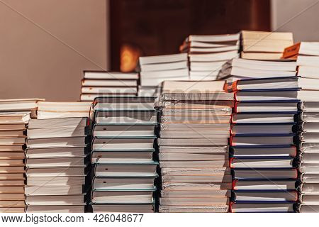 Stacks Of Books, Textbooks Lying On Table In City Bookshop. Education, School, Study Concept.